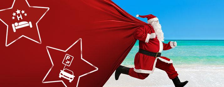 Weihnachtsmann mit Sack voller Reise-Extras
